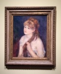 Young Woman Braiding Her Hair by Renoir (1876)