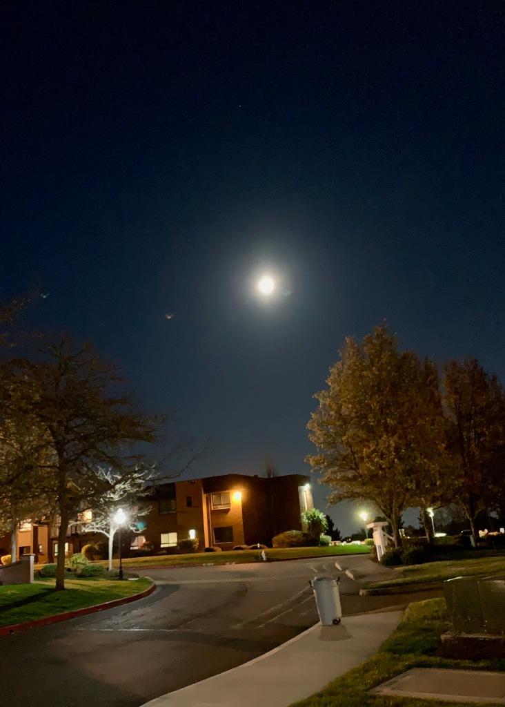Full moon over building, Tacoma, WA, USA, April 7, 2020