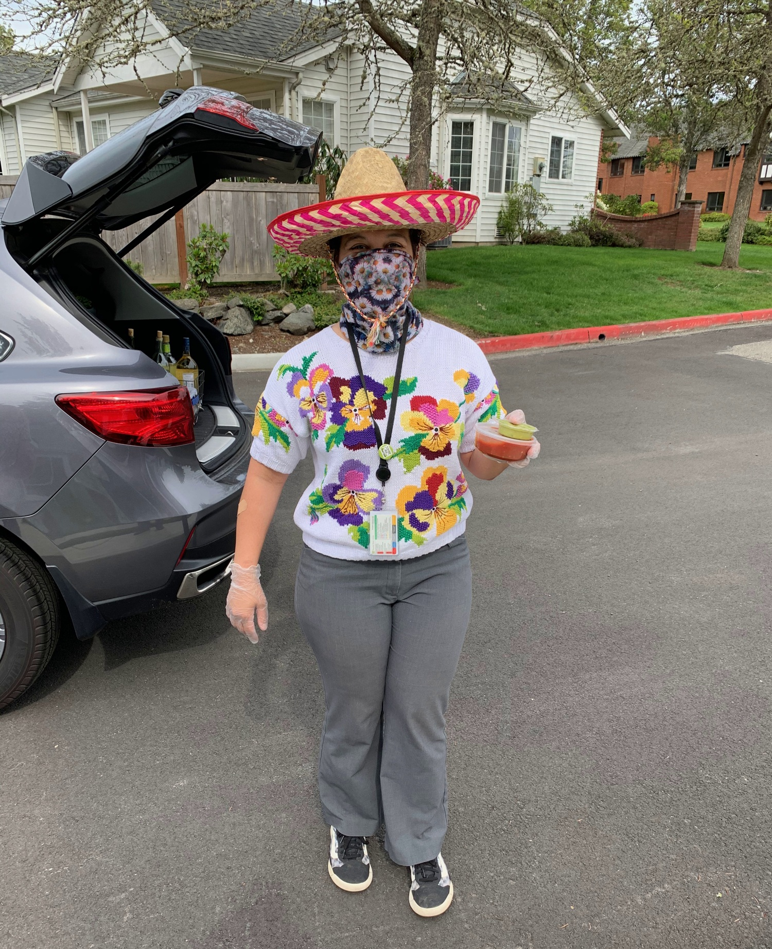 woman wearing sombrero and carry chips, guacamole, and salsa