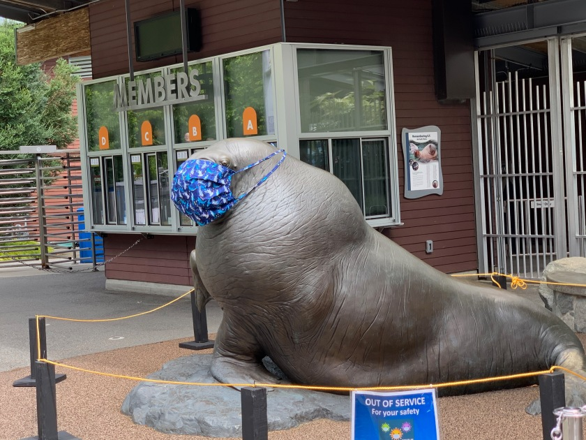 walrus statue wearing mast at zoo entrance