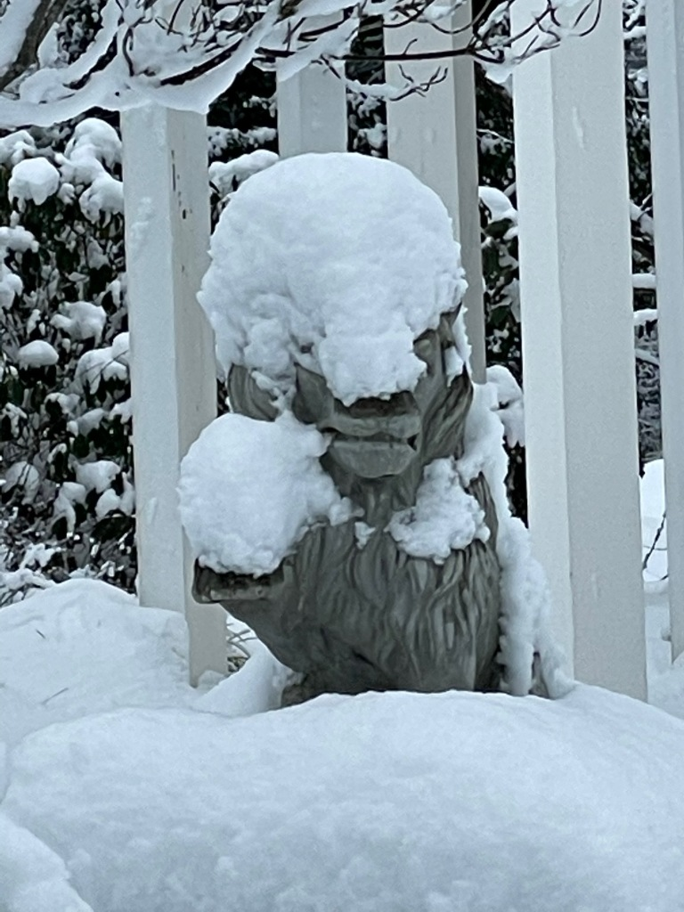lion statue nearly covered by snow